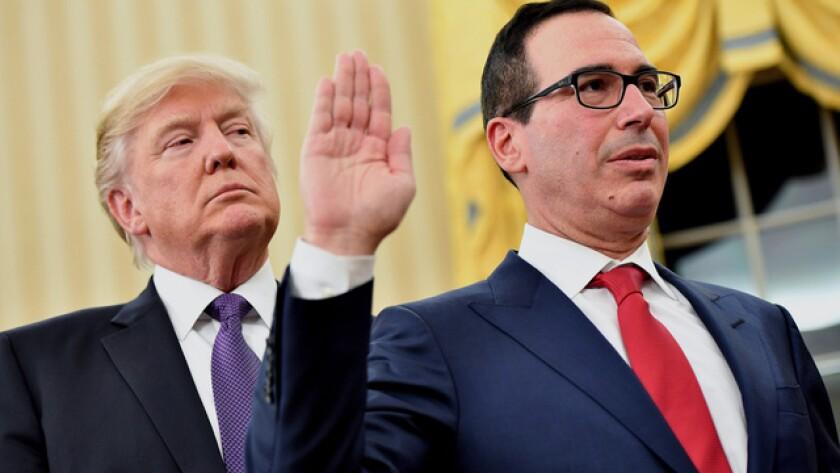 President Donald Trump swearing in Treasury Secretary Steven Mnuchin