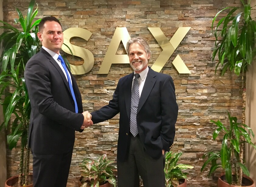 Kyle Stawicki (left), partner-in-charge of Sax Wealth Advisors, and Gregory Duffy (right), founder of Sterling Portfolio Management, now wealth advisor at SWA