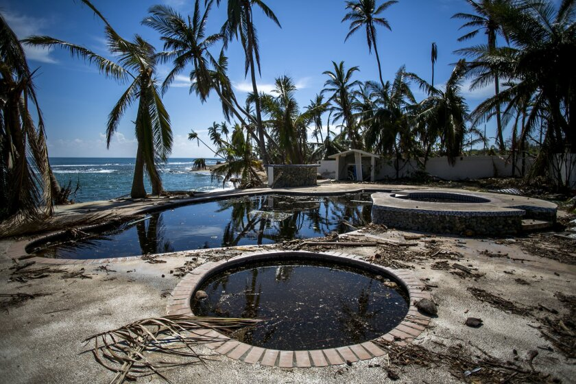 Debris sits near the pool of the damaged Caribe Playa Beach Resort after Hurricane Maria in Patillas, Puerto Rico.