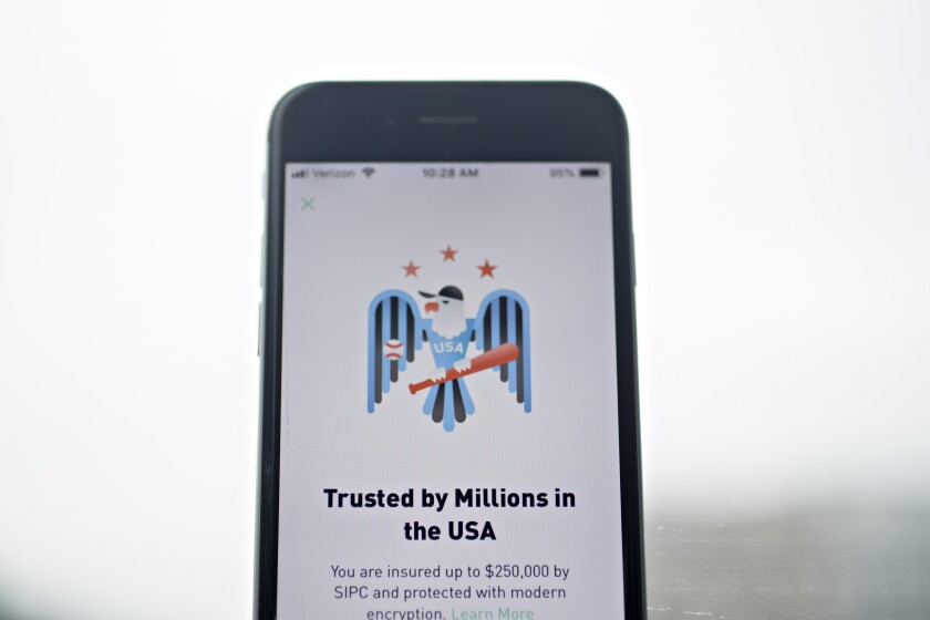 The Robinhood application is displayed on an Apple Inc. iPhone in an arranged photograph taken in Washington, D.C., U.S., on Friday, Dec. 14, 2018. The Securities Investor Protection Corp. said a new checking account from Robinhood Financial LLC raises red flags and that the deposited funds may not be eligible for protection. Photographer: Andrew Harrer/Bloomberg
