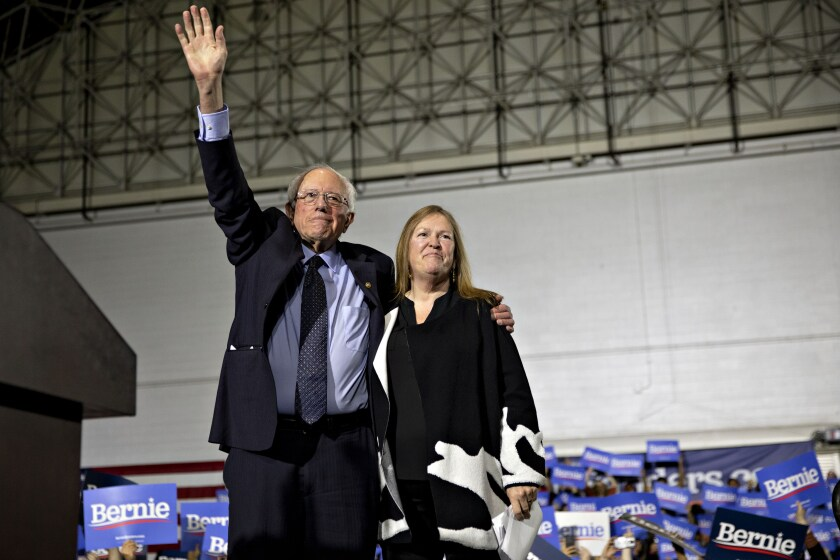 Senator Bernie Sanders, an Independent from Vermont and 2020 presidential candidate, left, stands with his wife Jane Sanders during a campaign rally in Chicago.