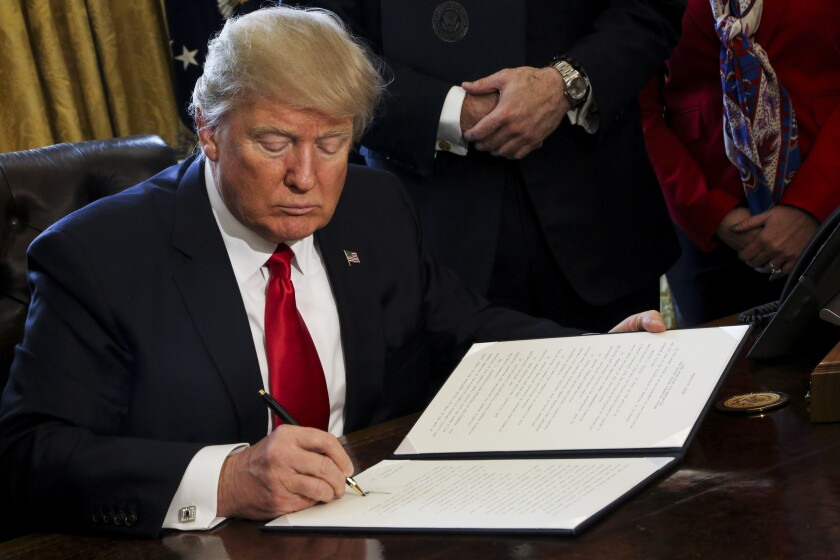 President Trump signs Dodd-Frank Bloomberg news