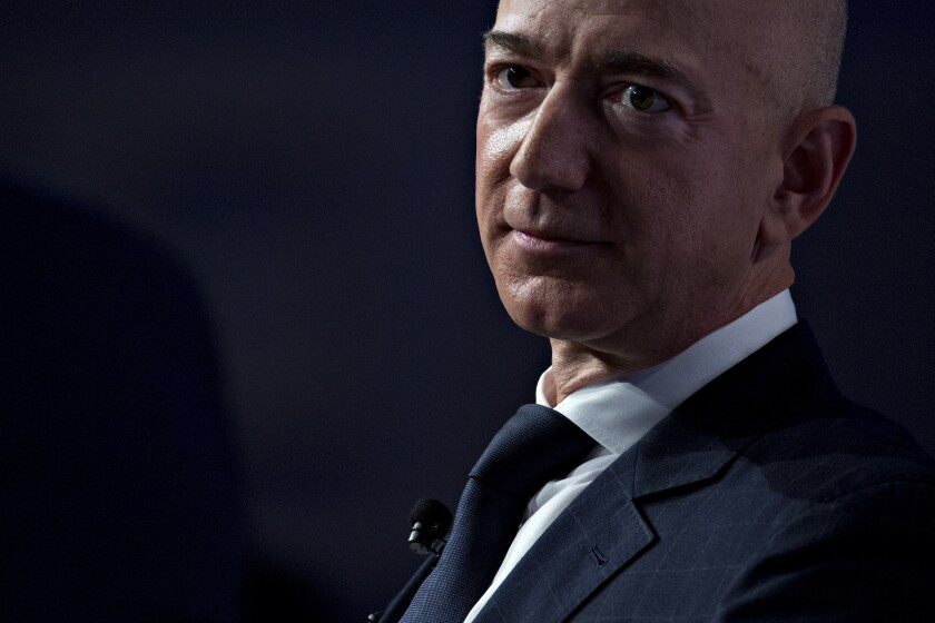 Jeff Bezos, founder and chief executive officer of Amazon.com Inc., listens during a discussion at the Air Force Association's Air, Space and Cyber Conference in National Harbor, Maryland, U.S., on Wednesday, Sept. 19, 2018. Amazon is considering a plan to open as many as 3,000 new AmazonGo cashierless stores in the next few years, according to people familiar with matter, an aggressive and costly expansion that would threaten convenience chains. Photographer: Andrew Harrer/Bloomberg