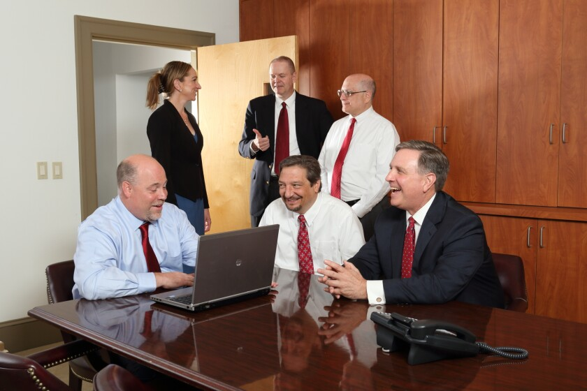 Seated front (left to right): William Gowie (founding partner), Louis Schiazza (partner) and Peter Barsz (partner). Standing (left to right):  Marissa Sperazza, Richard Brennan (partner) and Michael Amon (partner)