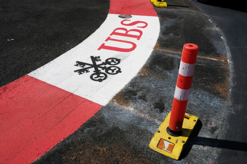 Branding for the Swiss bank, UBS Group AG, a sponsor of the Monaco Grand Prix is seen painted onto the road surface of the Formula One Grand Prix Circuit in Monte Carlo, Monaco, on Tuesday, May 29, 2018. The Monaco Grand Prix is the premier race on the Formula 1 calendar and has been held in one form or another since 1929 and in modern form since 1950. Photographer: Bryn Colton/Bloomberg
