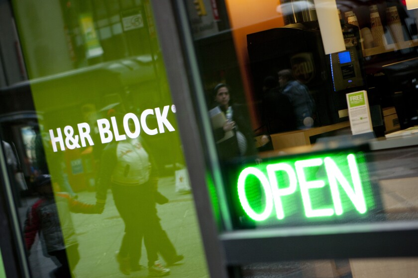 The H&R Block, Inc. logo is displayed in front of the company's flagship office in New York, U.S., on Friday, March 3, 2012. H&R Block, Inc. provides tax services to the general public, accounting and consulting services, and consumer financial and personal productivity software. Photographer: Scott Eells/Bloomberg
