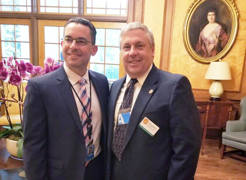 NCCPAP president Stephen Mankowski (r) at the White House with Paul Teller, the special assistant to the president for legislative affairs.
