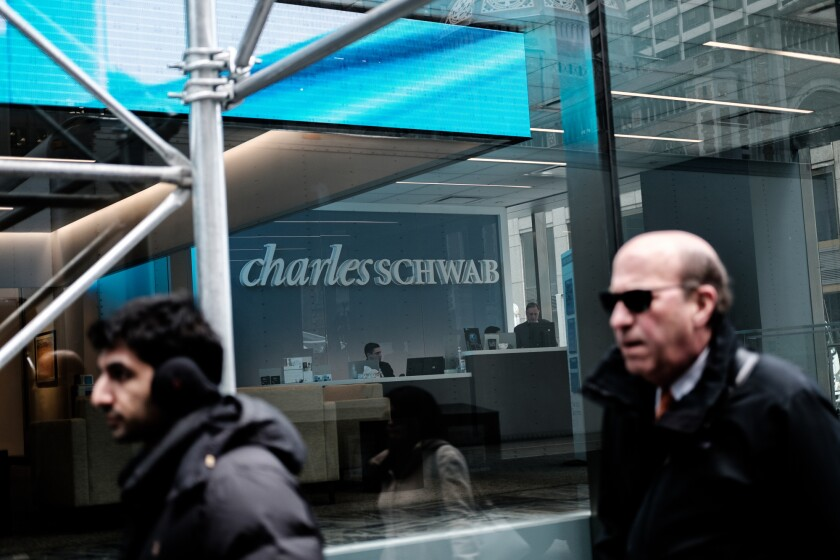 A person enters a Charles Schwab Corp. office building in New York, U.S., on Thursday, Jan. 10, 2019. Charles Schwab Corp. is scheduled to release earnings on January 16. Photographer: Gabriella Angotti-Jones/Bloomberg