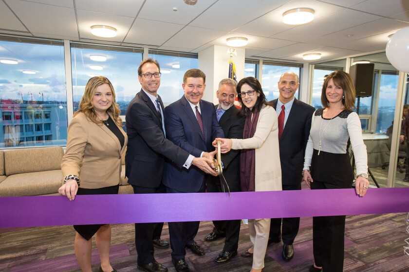 (L to R) Arlington Chamber of Commerce President and CEO Kate Bates, Arlington County Board Chair Jay Fisette, Grant Thornton CEO Mike McGuire, Grant Thornton Public Sector National Managing Partner Carlos Otal, Grant Thornton Tax Services National Managing Partner Jamie Fowler, Arlington Economic Development Director Victor Hoskins, and Rosslyn Business Improvement District President Mary-Claire Burick pose at the grand opening of Grant Thornton LLP's new Metro DC office on Feb. 9, 2017.