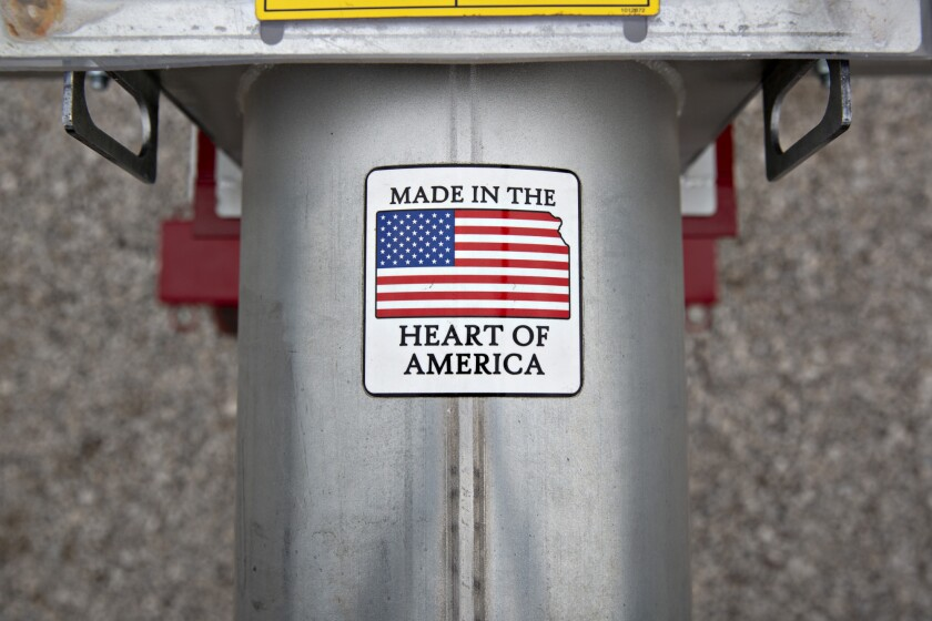 "A ""Made In The Heart Of America"" sticker is displayed on grain loading equipment on display during the Farm Progress Show in Boone, Iowa."