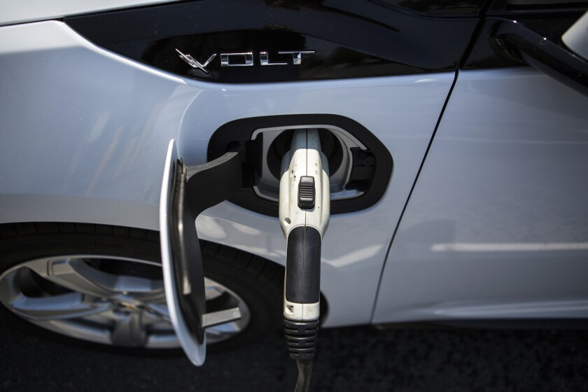 A ClipperCreek Inc. charging plug connected to a General Motors Chevrolet Volt electric vehicle at a charging station in Los Angeles