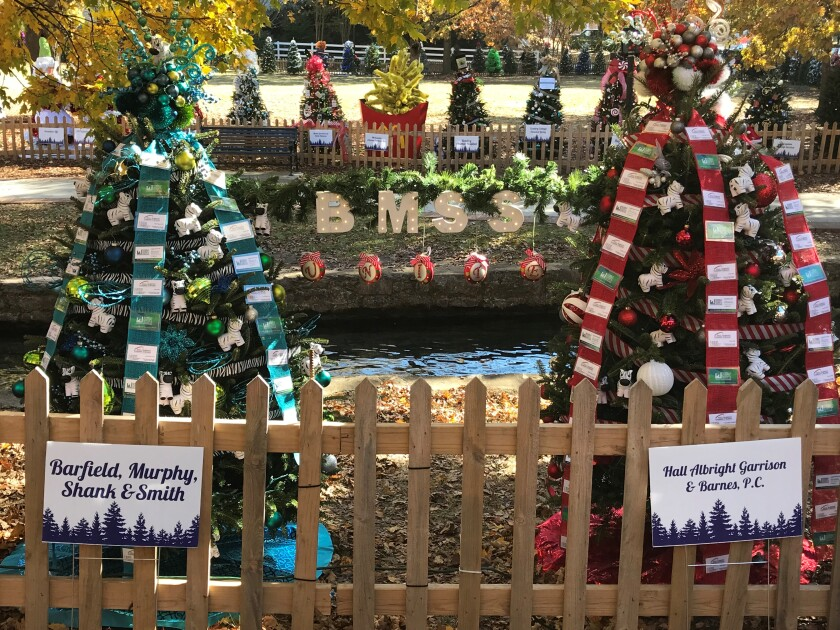 Barfield, Murphy, Shank & Smith and Hall Albright Garrison & Barnes celebrated their merger with this image of the two firms' Christmas trees featured in the annual Tinsel Trail in Downtown Huntsville, Alabama.
