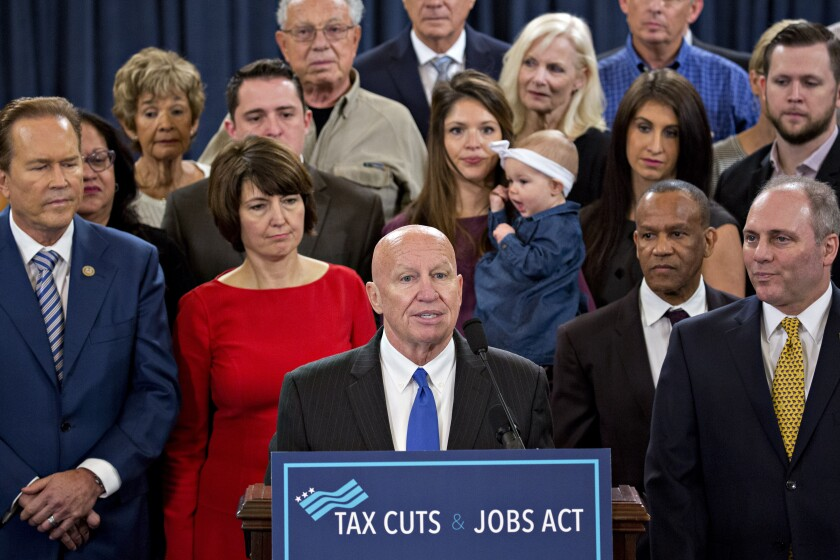 Representative Kevin Brady, a Republican from Texas and chairman of the House Ways and Means Committee, center, speaks as House Majority Whip Steve Scalise, a Republican from Louisiana, right, listens during a news conference on tax reform in Washington, D.C., U.S., on Thursday, Nov. 2, 2017.