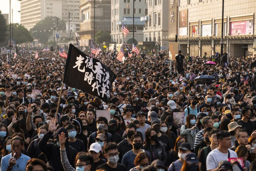 """Demonstrators occupied the street during a protest in the Tsim Sha Tsui district of Hong Kong, China, on Sunday, Dec. 1, 2019. China said it """"strongly"""" opposed an op-ed by United Nations High Commissioner for Human Rights Michelle Bachelet, accusing her of meddling in the country's affairs and emboldening Hong Kong protesters to commit violence. Photographer: Chan Long Hei/Bloomberg"""