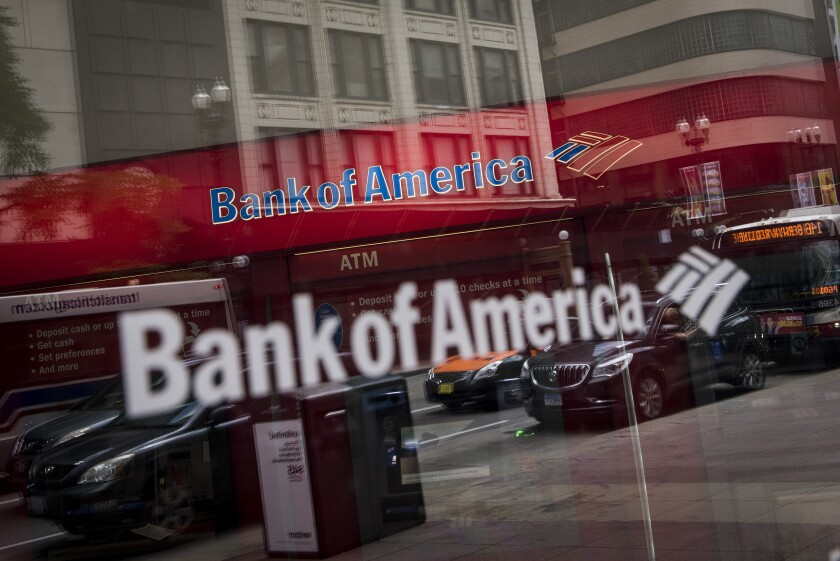 Vehicles are reflected in the window of a Bank of America branch in Chicago, July 9, 2017 Bloomberg News