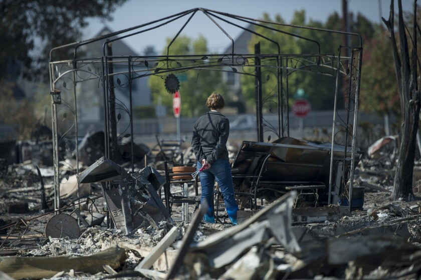 Resident views personal items burned by wildfires in Santa Rosa, California, U.S., on Thursday, Oct. 12, 2017.