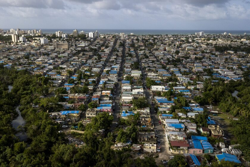 Blue roof temporary tarps are seen in an aerial photograph taken over San Juan, Puerto Rico.