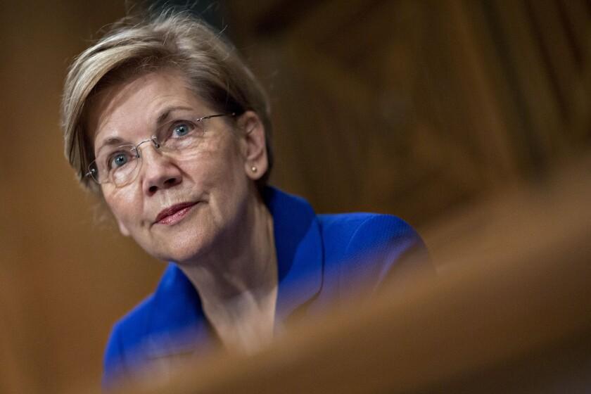 Sen. Elizabeth Warren, D-Mass., listens during a Senate Banking Committee hearing in Washington on the Equifax cybersecurity breach.