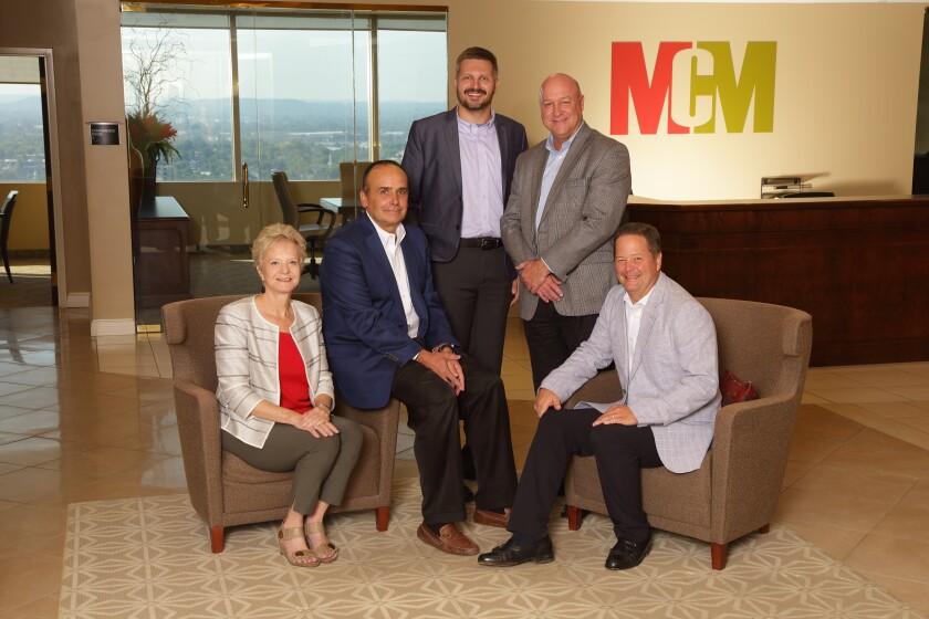 Diane Medley, Brad Smith, Nate Deskins, Steve Kerrick and Jim Kramer of MCM CPAs & Advisors and MCM Kramer Technology Solutions