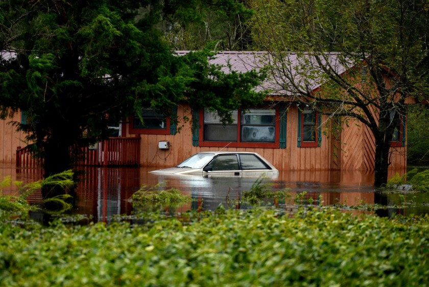 A car stands partially submerged in floodwaters during Tropical Storm Florence near Beulaville, North Carolina.