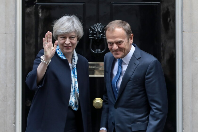 U.K. Prime Minister Theresa May outside her residence at 10 Downing Street in London with European Union President Donald Tusk