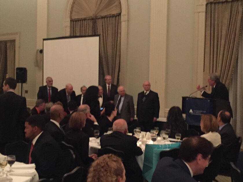 Accountants Club of America president Robert Fligel salutes some of the past presidents of the club