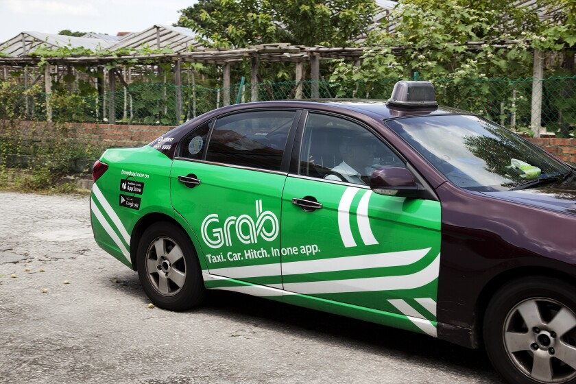 A Grab-branded taxi