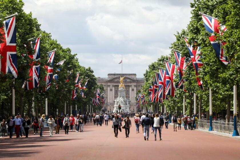 Buckingham palace with English flags