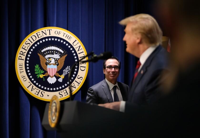Treasury Secretary Steven Mnuchin watches President Donald Trump