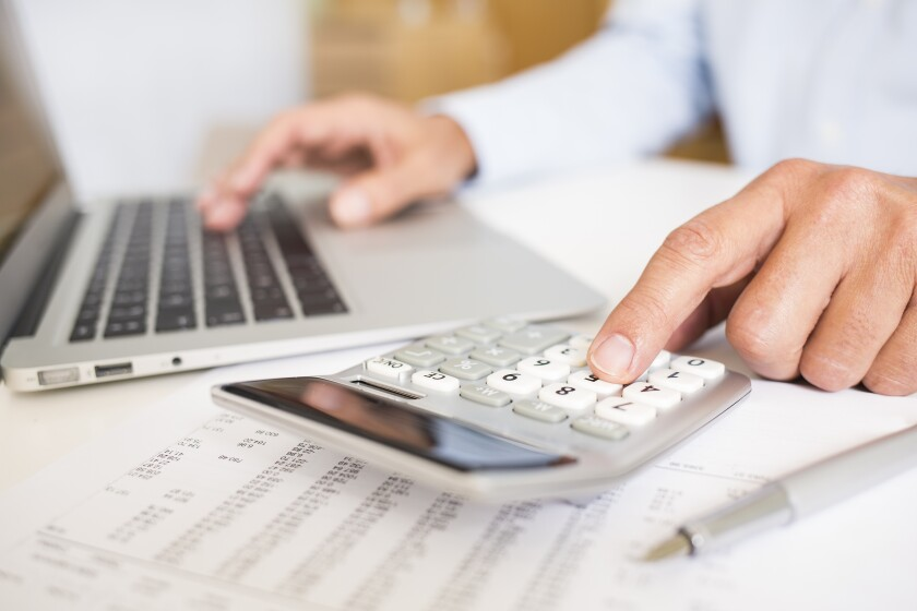 Accounting and analysis with laptop and calculator