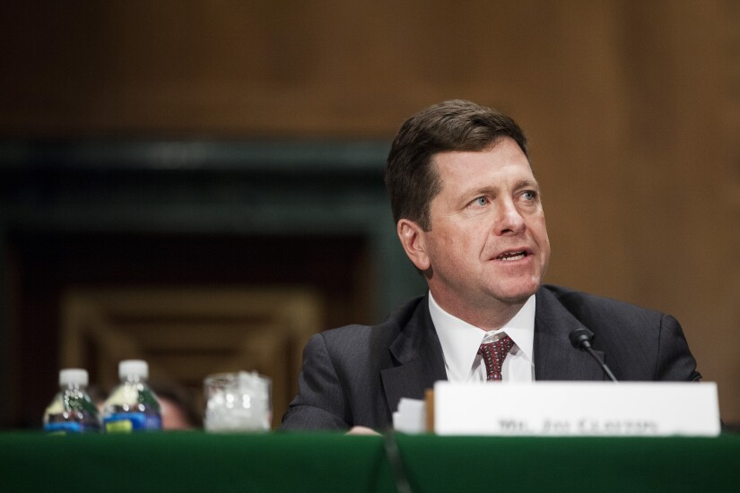 Jay Clayton, SEC Chair nominee, sits at table during a Senate Banking Committee confirmation hearing