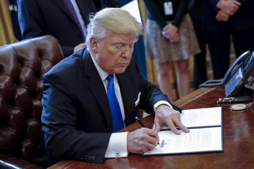 Donald Trump signing an executive order