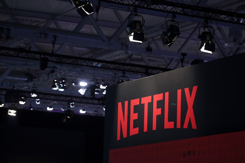 A Netflix Inc. logo sits on the online television streaming company's exhibition area at the Gamescom gaming industry event in Cologne, Germany, on Tuesday, Aug. 20, 2019.  Photographer: Krisztian Bocsi/Bloomberg