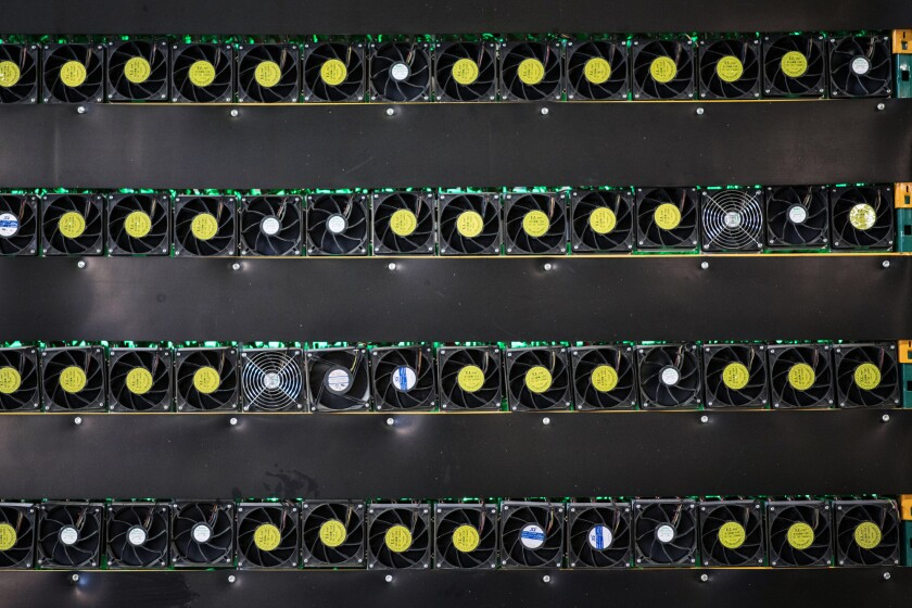 Cryptocurrency mining rigs sit on racks at a Bitfarms facility in Saint-Hyacinthe, Quebec, Canada.