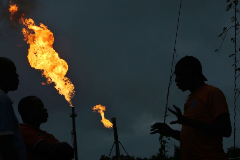 Gas flares burn from pipes at an oil flow station operated by Nigerian Agip Oil Co. Ltd. (NAOC), a division of Eni SpA, in Idu, Rivers State, Nigeria, on Monday, Sept. 28, 2015. Nigeria's daily output of about 2 million barrels of oil makes it Africa's largest producer. Photographer: George Osodi/Bloomberg