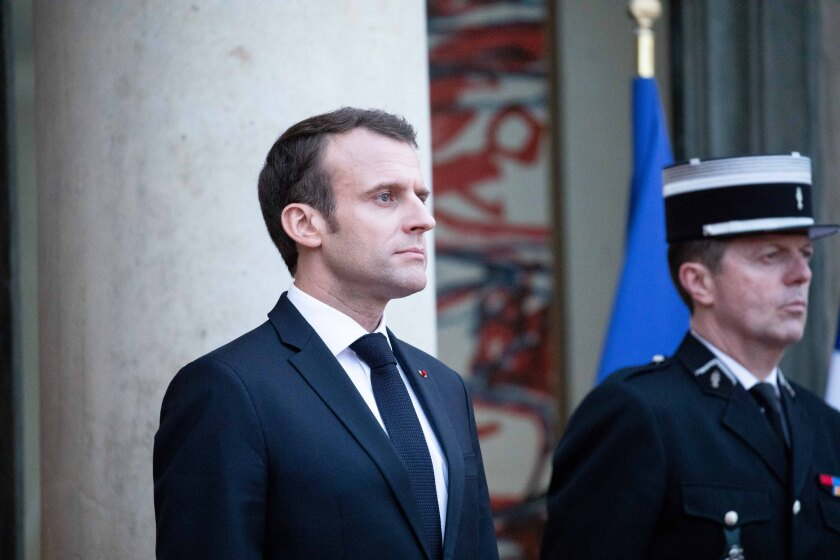 French President Emmanuel Macron (left)