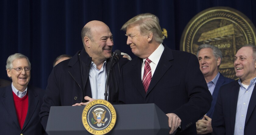 President Donald Trump, center right, and Gary Cohn, director of the U.S. National Economic Council, center left, smile during a press conference with cabinet members and Republican leadership at Camp David.