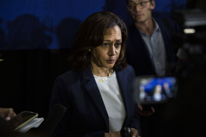 Senator Kamala Harris, a Democrat from California and 2020 presidential candidate, listens to a question from a reporter during a town hall event in Somersworth, New Hampshire.