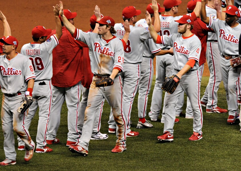 Philadelphia Phillies players congratulate one another after defeating the Tampa Bay Rays in game one of the World Series in 2008.