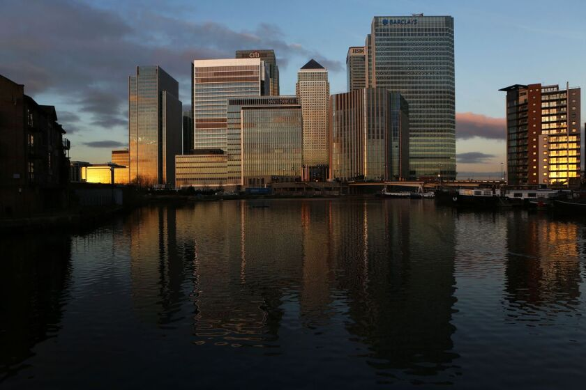 The headquarters of Barclays and HSBC Holdings stand among the offices of Citigroup, State Street and other financial firms in the Canary Wharf business district of London.
