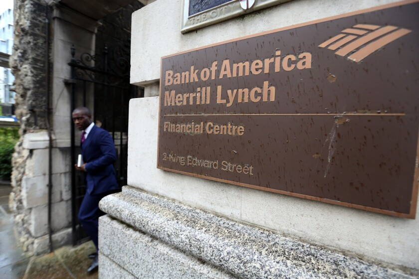 Man walking past entrance Bank of America Merrill Lynch in London Oct. 9, 2014 Bloomberg News