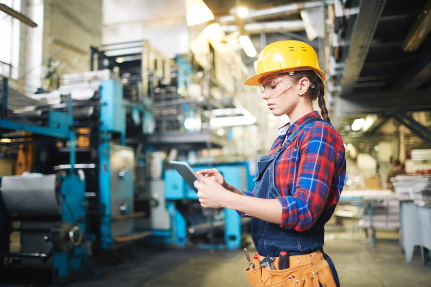 Manufacturing female engineer with mobile device.jpeg