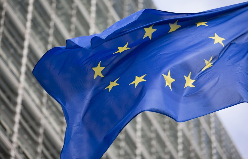 A flag of the European Union flies outside the European Commission building in Brussels, Belgium.