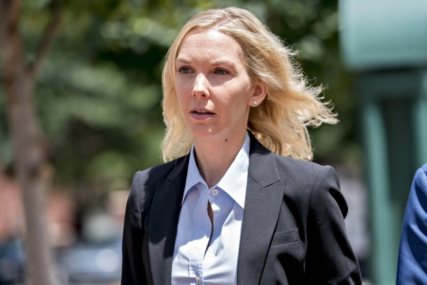 Heather Washkuhn, manager of Paul Manafort's personal and business finances, walks toward District Court in Alexandria, Virginia.