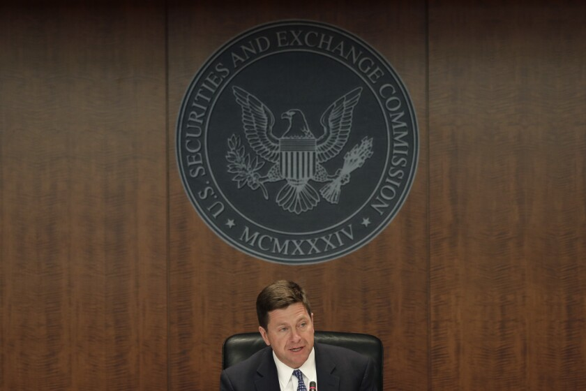 Jay Clayton, chairman of U.S. Securities and Exchange Commission (SEC), speaks during an SEC open meeting in Washington, D.C., U.S., on Wednesday, April 18, 2018. Clayton unveiled a new approach that will attempt to address legal and regulatory uncertainties that were largely triggered by the Labor Department's rules.