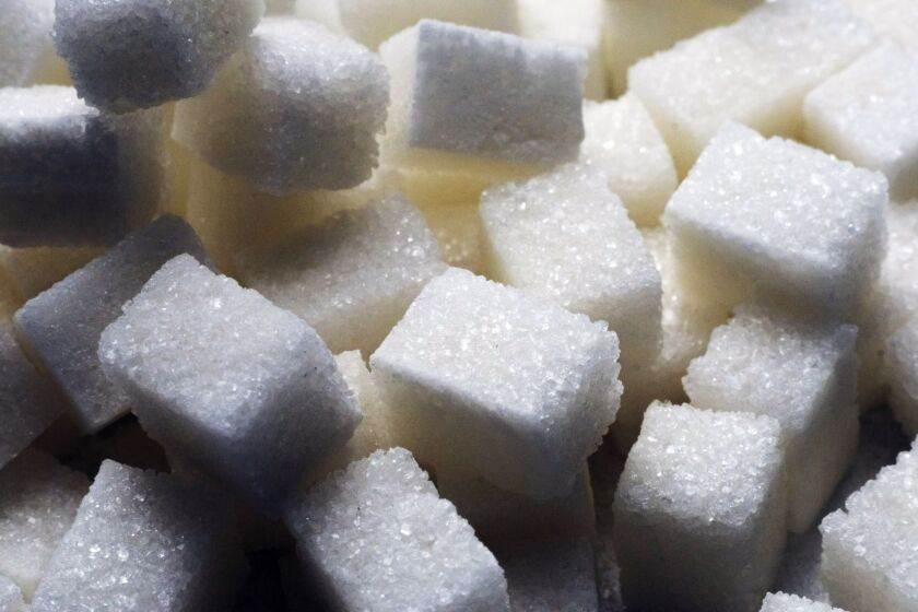 Piles of refined white sugar cubes sit at the ED&F Man Ltd. refinery in Nikolaev, Ukraine