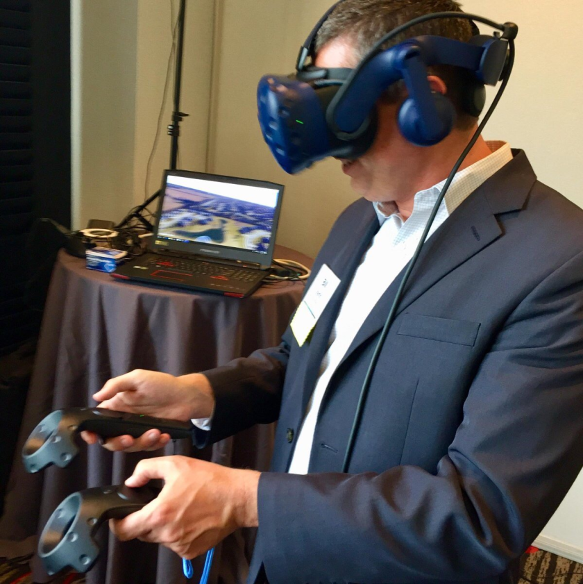 Bill Martin, chief investment officer at Wichita, Kansas-based INTRUST Bank, tries out VR goggles at Fidelity Investments' client advisory council meeting in Boston.