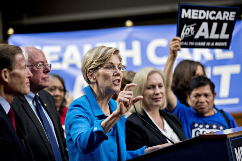 Senator Elizabeth Warren, a Democrat from Massachusetts, center, speaks during a health care bill news conference on Capitol Hill in Washington, D.C., alongside Senators Richard Blumenthal, D-Conn., Bernie Sanders, I-Vt., and Kirsten Gillibrand, D-N.Y.