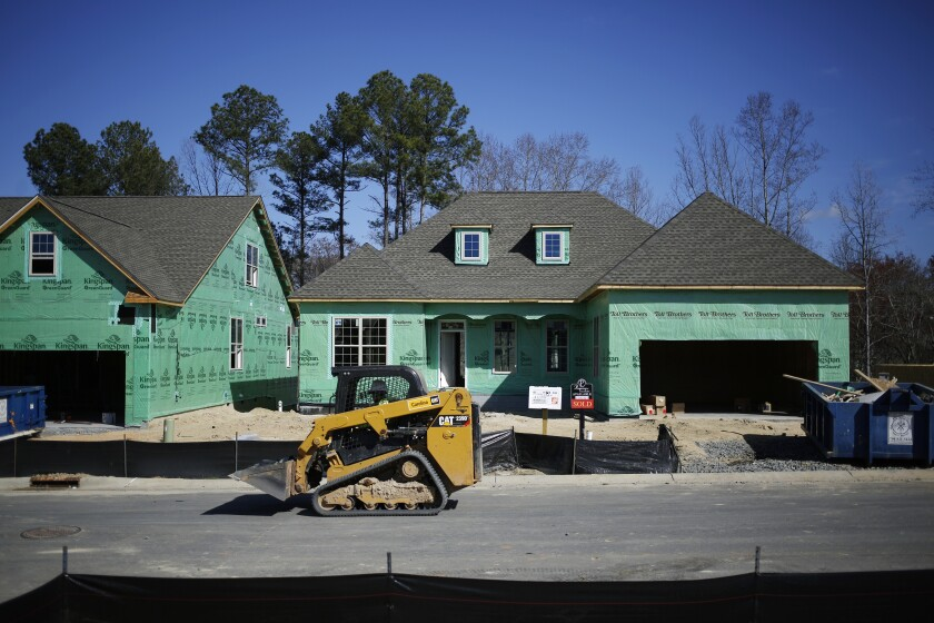 A Caterpillar Inc. 239D compact track loader drives past a home under construction in the Toll Brothers Inc. Regency at Palisades community in Charlotte, North Carolina, U.S., on Friday, Feb. 24, 2017. The U.S. Census Bureau released construction spending figures on March 1. Photographer: Luke Sharrett/Bloomberg