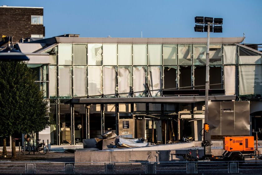 General view of damage to the entrance at the front of the Danish Tax Authority at Oesterbro in Copenhagen, Denmark, on August 7, 2019, after a powerful explosion near Nordhavn Station, late on August 6.